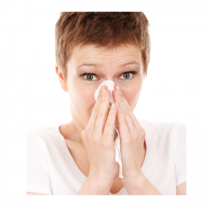 Picture of woman blowing her nose with a tissue