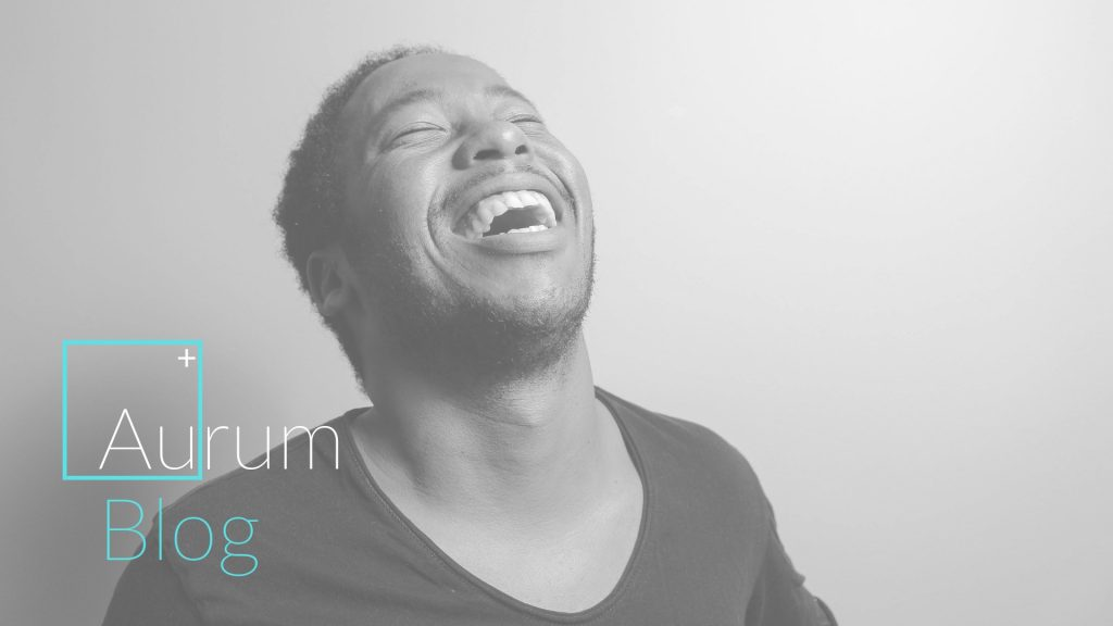Man laughing and happy with label that says aurum talks.